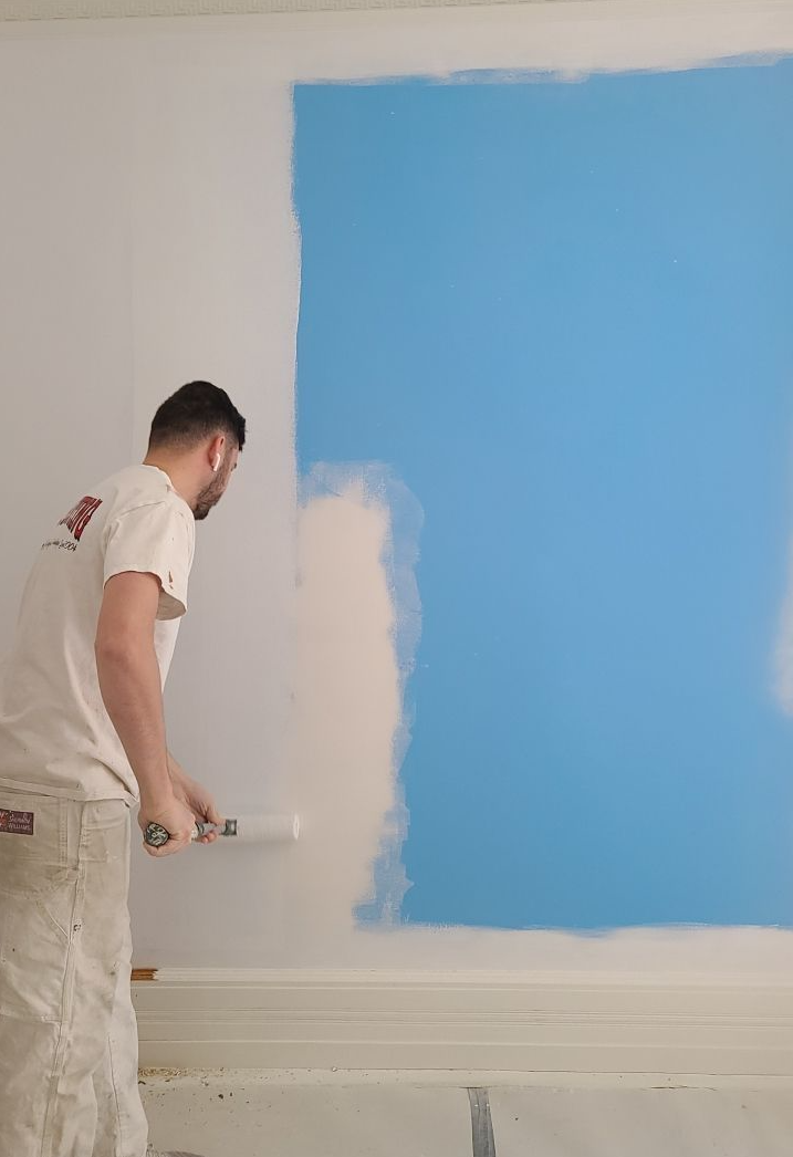 Bruno Painting painting a wall