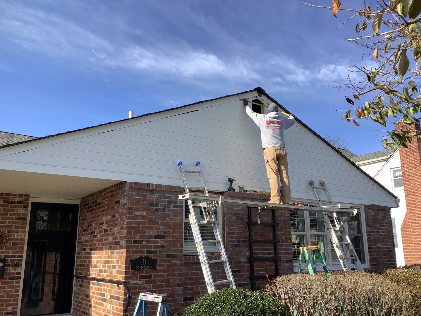 Bruno Painting fixes a roof